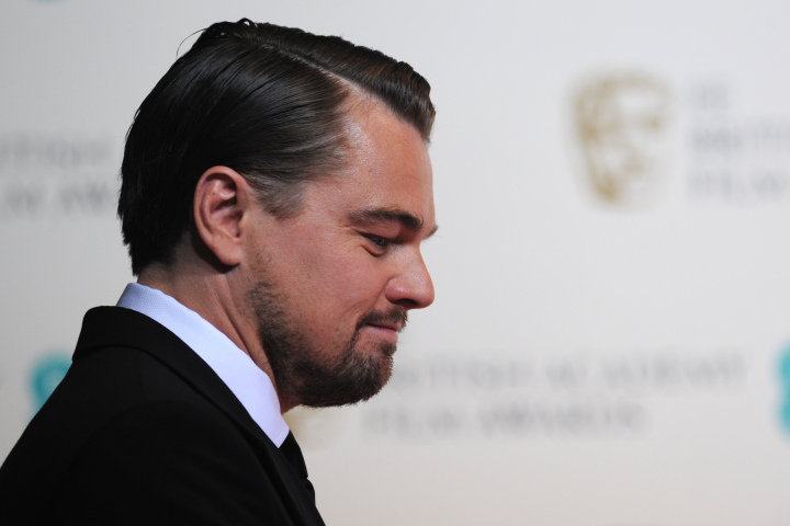 US actor Leonardo DiCaprio poses after presenting an award at the BAFTA British Academy Film Awards at the Royal Opera House in London on February 16, 2014. AFP PHOTO / CARL COURT        (Photo credit should read CARL COURT/AFP/Getty Images)